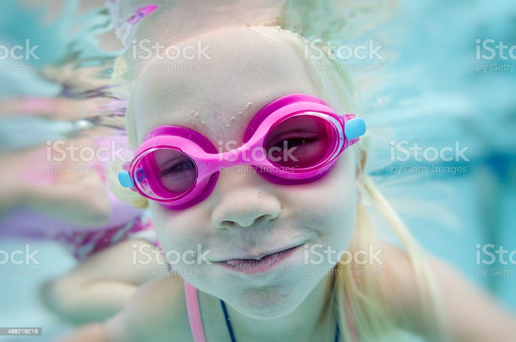 Little girls playing underwater stock photo