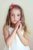Little girl's portrait.Tender serious child looking at camera.Young fashion model