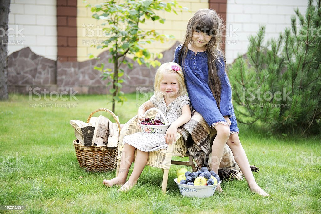 Little girls posing for the camera in park royalty-free stock photo
