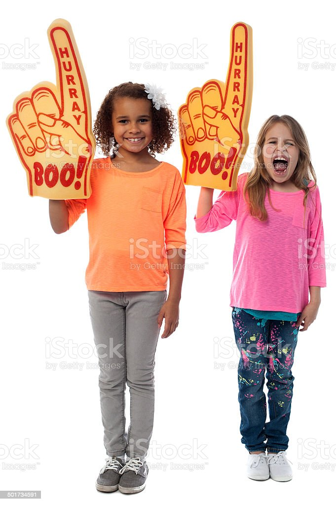 Little girls raises arms with foam finger royalty-free stock photo