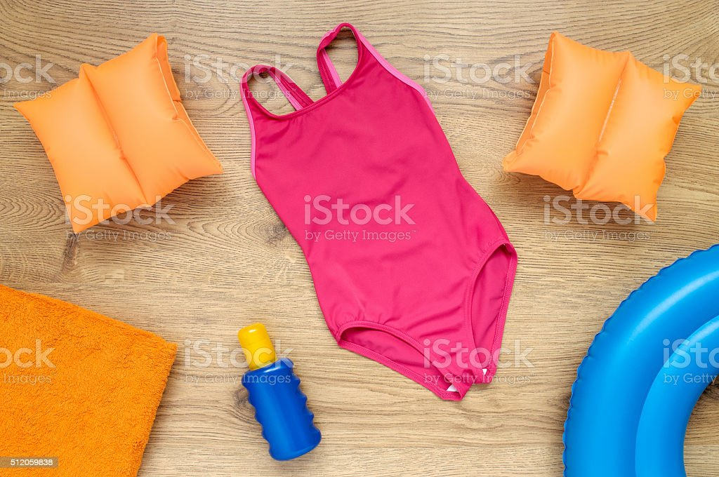 Little girl's summer vacation accessories stock photo