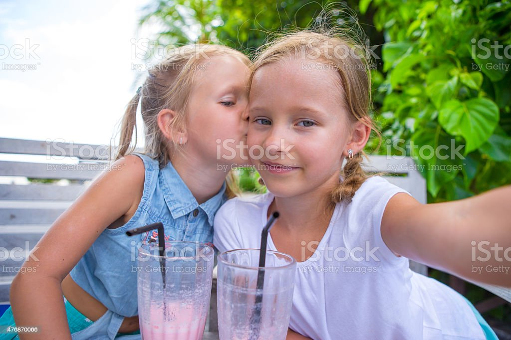 Little Girls Taking Selfie And Drinking Tasty Cocktails At