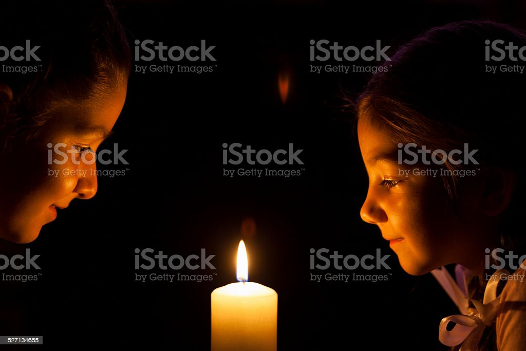 Little Girls With Candle stock photo