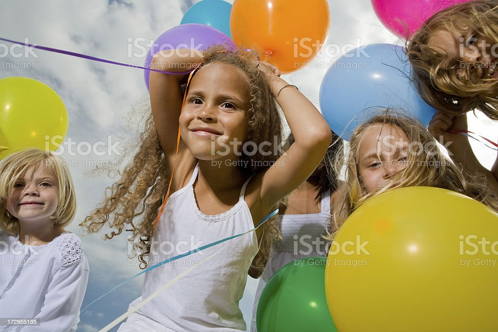Little girls with multicolored balloons royalty-free stock photo
