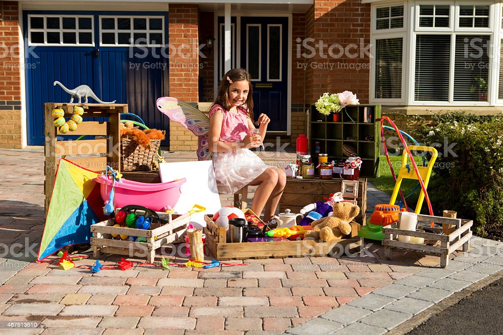 Little Girl's Yard Sale stock photo