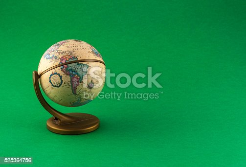 a Little globe on colored background, south america view