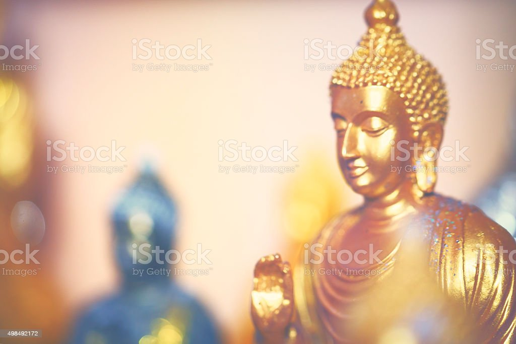 Little golden Buddha stock photo