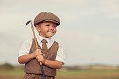 Little Golfing Boy in Vintage Attire