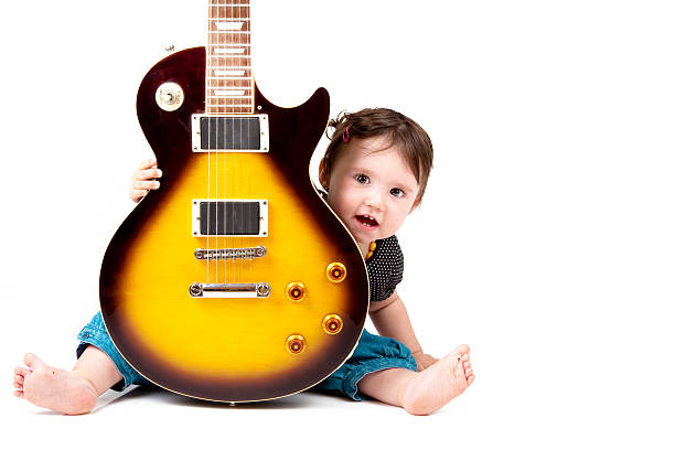 Little guitarist on a white background. stock photo