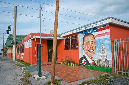 Miami, USA. December 22, 2009. A retaurant in Little Haiti exhibits a mural in suport of presidential candidate Barak Obama.