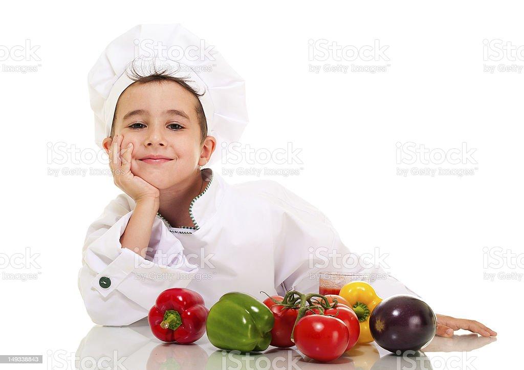 Kleinen glücklichen Jungen Koch in uniform mit vegatables lean hand – Foto
