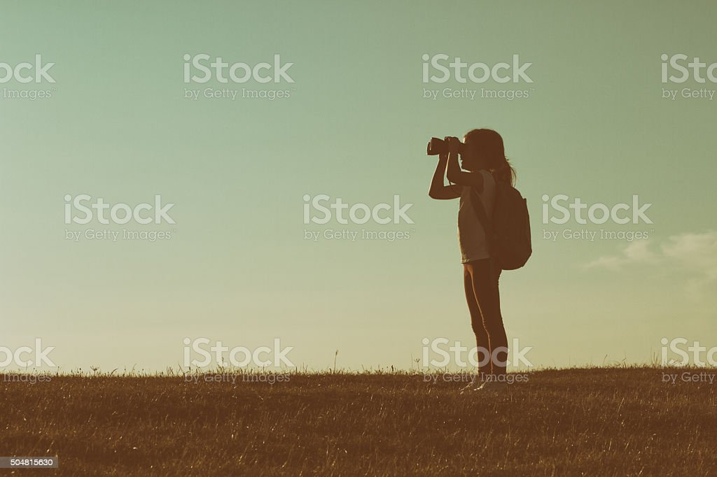 Little hiker with binoculars stock photo