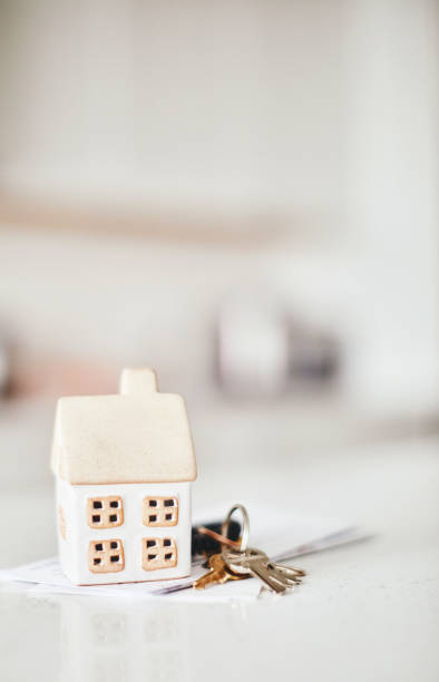 Little home on kitchen counter with keys and paperwork stock photo