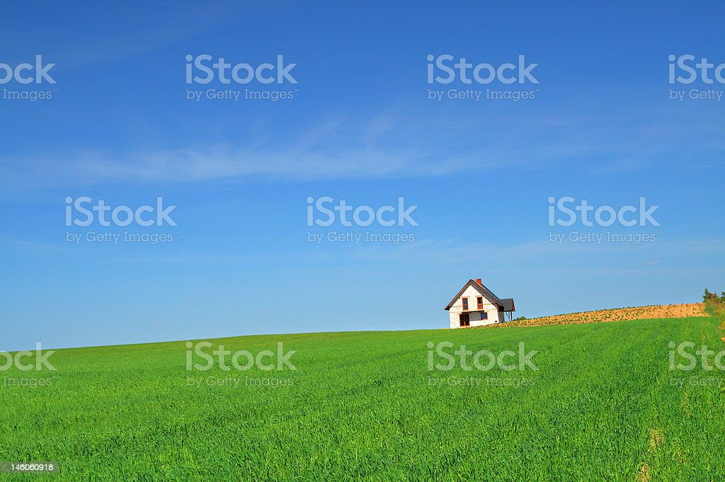 little house in grass field royalty-free stock photo