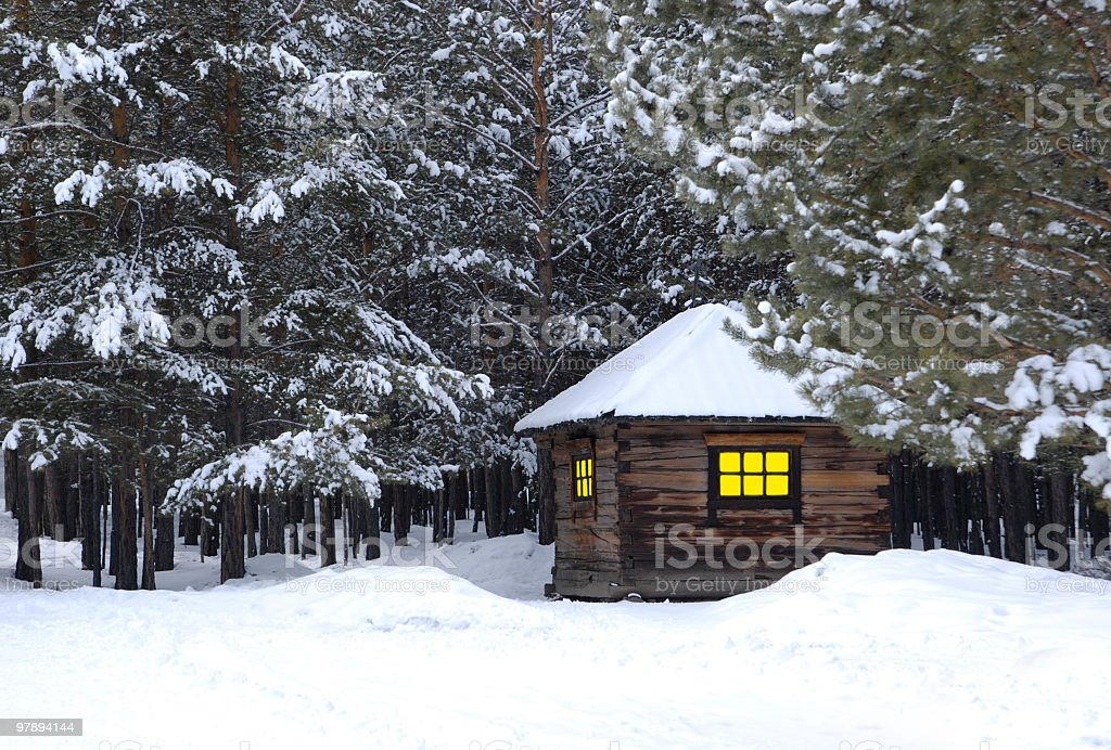 little house in winter forest royalty-free stock photo