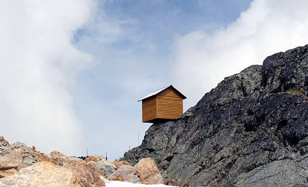 Little House on the Precipice - Blue Sky Thinking stock photo