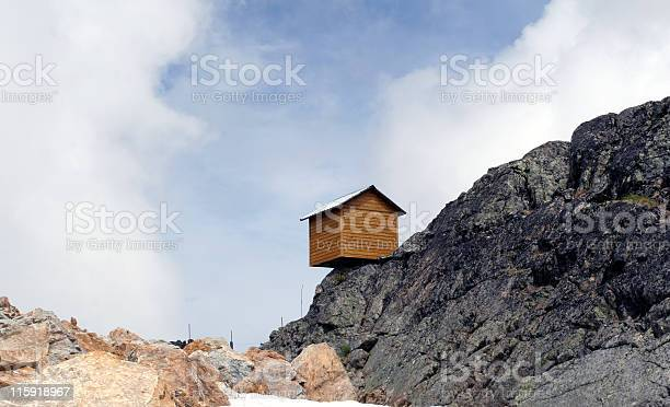 Little House On The Precipice Blue Sky Thinking Stock Photo - Download Image Now