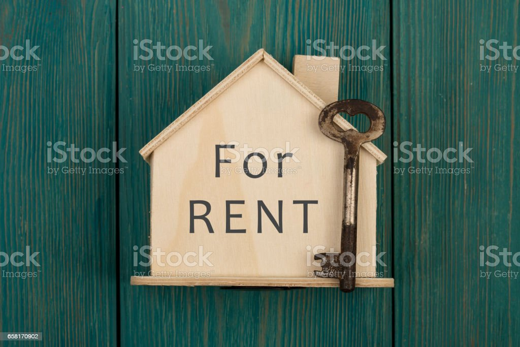 """Little house with text """"For rent"""" and key royalty-free stock photo"""