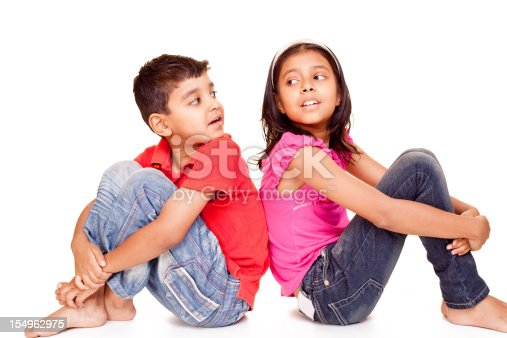 istock Little Indian Brother Sister Sitting Isolated on White 154962975