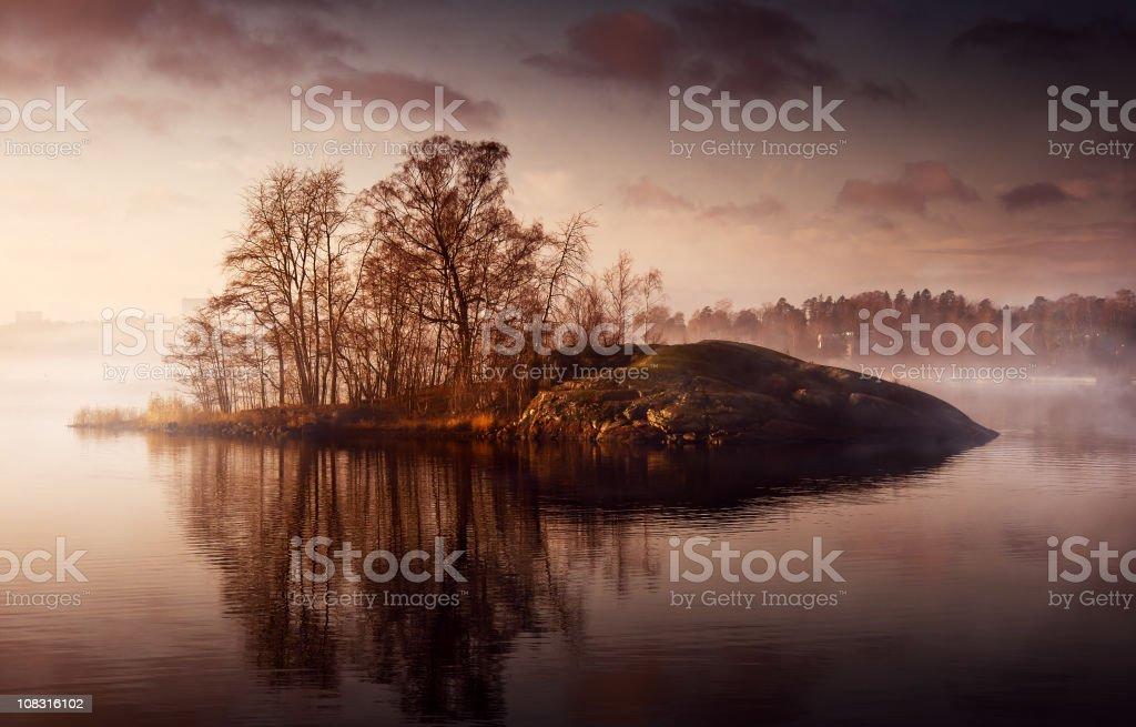 Little island in fog royalty-free stock photo