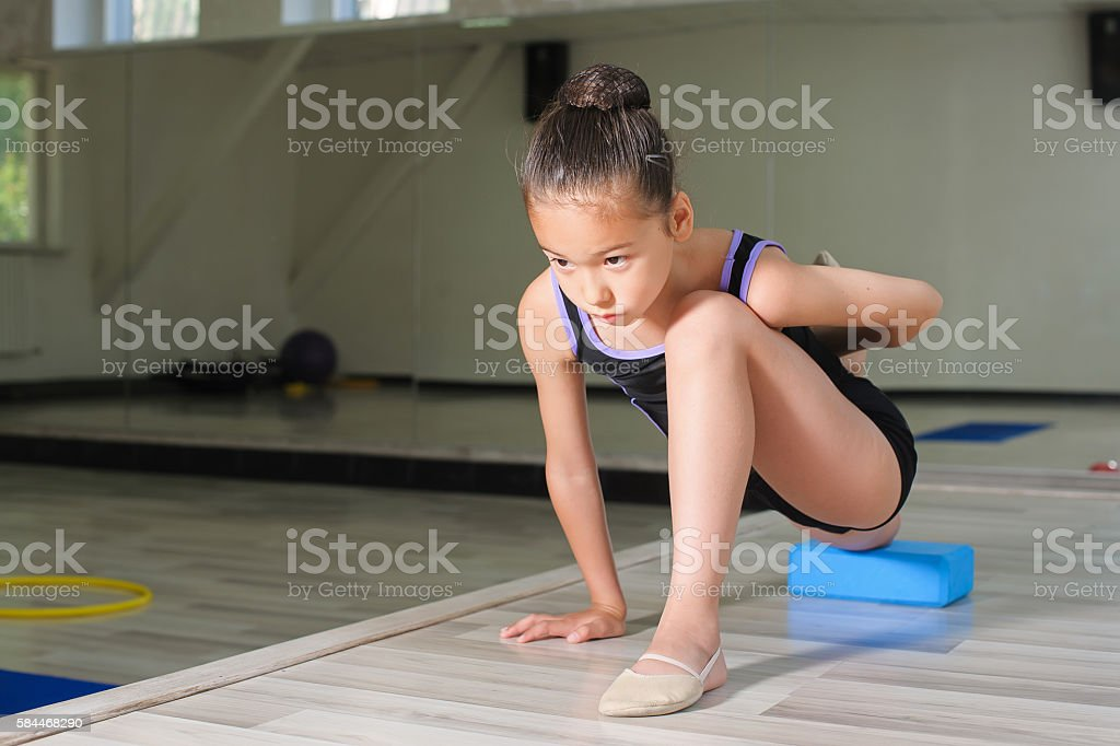 Little Japanese Girl In Gymnastics Stock Photo - Download