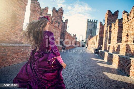 Little Juliet Capulet running on Verona bridge.  Nikon D850.