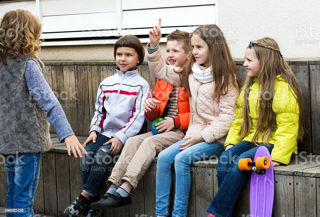 Little kid acting out phrase to friends royalty-free stock photo