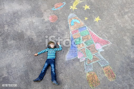 istock little kid boy flying by a space shuttle chalks picture 678753200