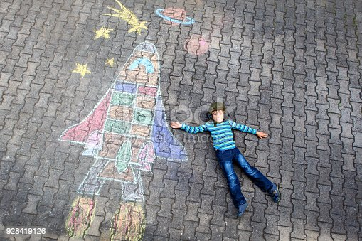 istock little kid boy flying by a space shuttle chalks picture 928419126