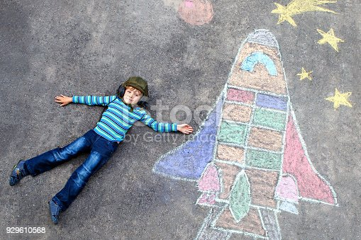 istock little kid boy flying by a space shuttle chalks picture 929610568