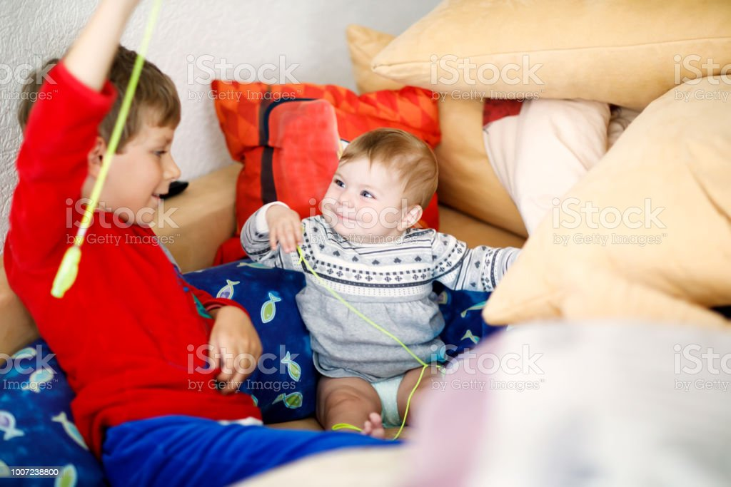 5dc4a9242172 Little Kid Boy Hugging With Newborn Baby Girl Cute Sister Brother On ...