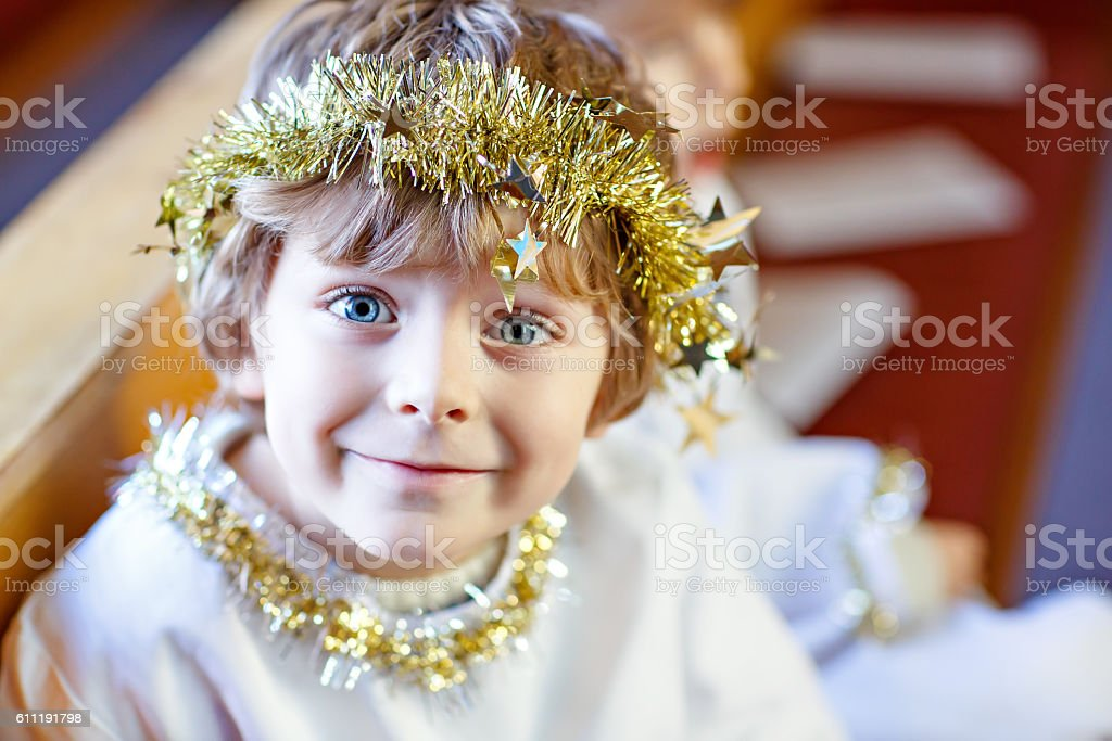 little kid boy in church on Christmas eve stock photo