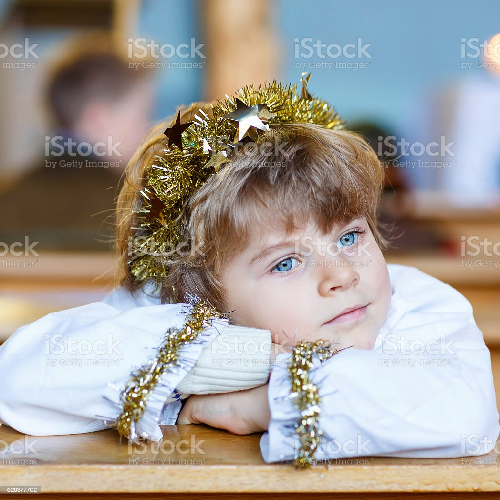 little kid boy in church on Christmas eve zbiór zdjęć royalty-free