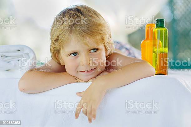 Little Kid Boy Relaxing In Spa With Enjoying Massage Stock Photo - Download Image Now