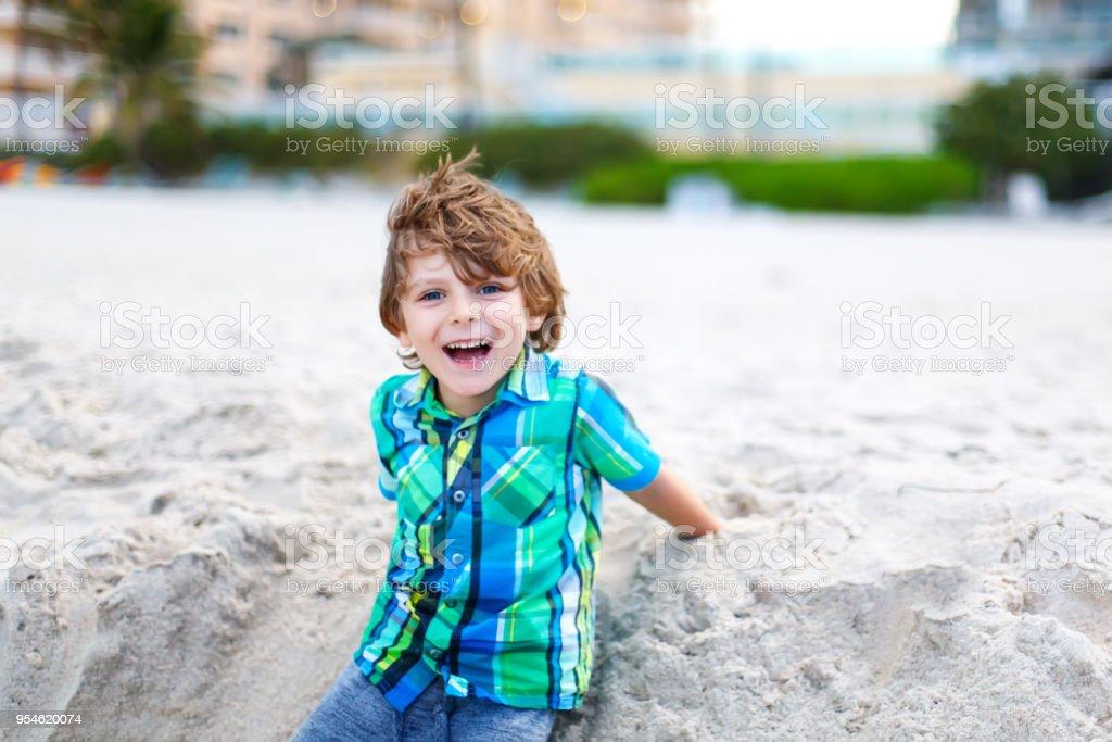 Little Kid Boy Running On The Beach Of Ocean Stock Photo More