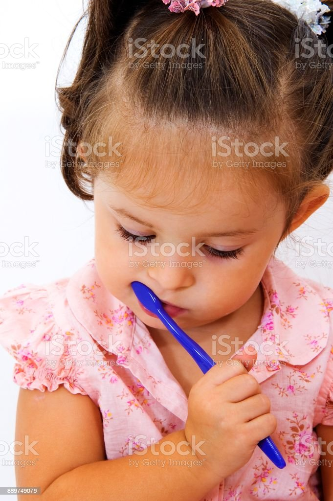 Little kid brushing the teeth stock photo