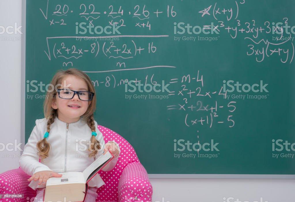 little kid girl teaching reading board stock photo