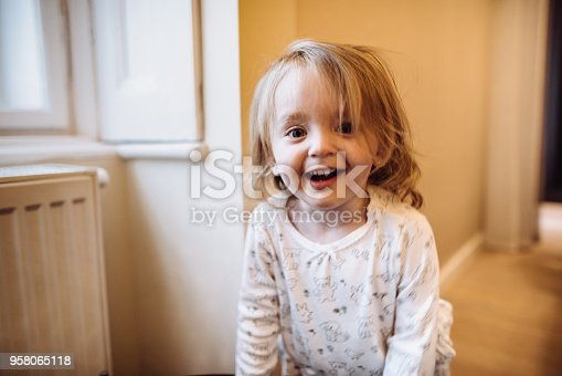 678589610istockphoto little kid happiness at home 958065118