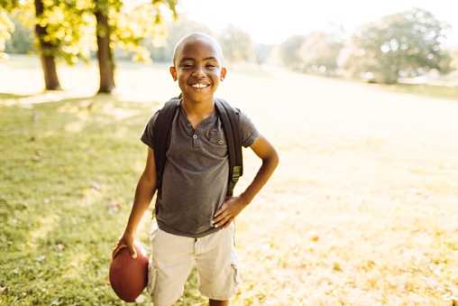 istock little kid happiness with football ball 1143723130