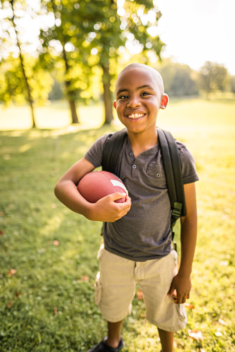 istock little kid happiness with football ball 865515368