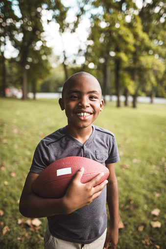 istock little kid happiness with football ball 866049300