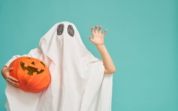 little kid in ghost costume stock photo
