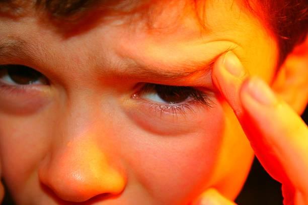 Little Kid Migraine stock photo