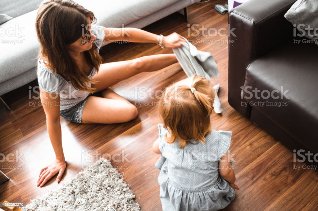 little kid playing with mom on the couch royalty-free stock photo