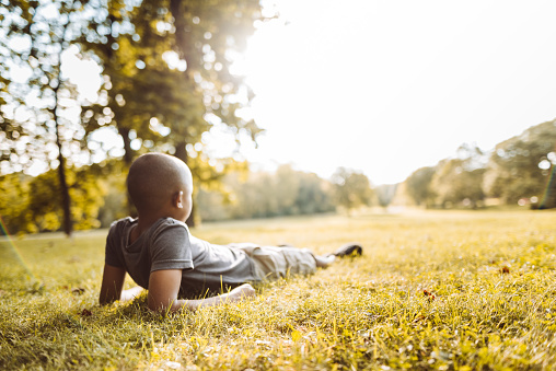 istock little kid resting in the park 1143456187