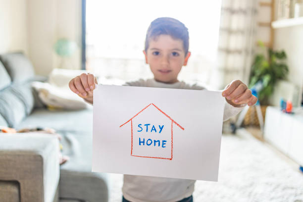Little kid with Stay Home draw. Coronavirus concept Little kid with Stay Home draw. Coronavirus concept stay at home order stock pictures, royalty-free photos & images