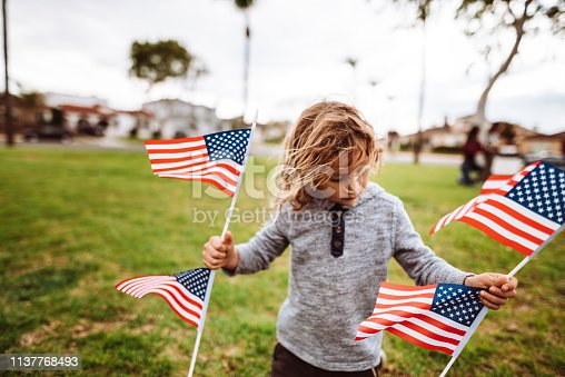 little kid with us national flag for the fourth of july