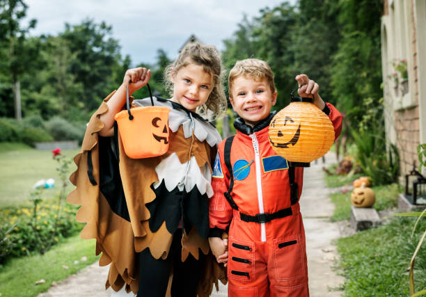 Little kids at Halloween party stock photo