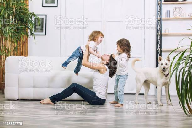 Little kids girls are beautiful and cute with mother and pet dog at picture id1133392778?b=1&k=6&m=1133392778&s=612x612&h=fpejgamyloozah w2ju9fytwr6xxjeddxrufw6eh22i=
