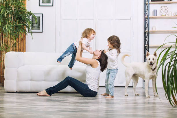 little kids girls are beautiful and cute with mother and pet dog at home together happy - happy dog imagens e fotografias de stock